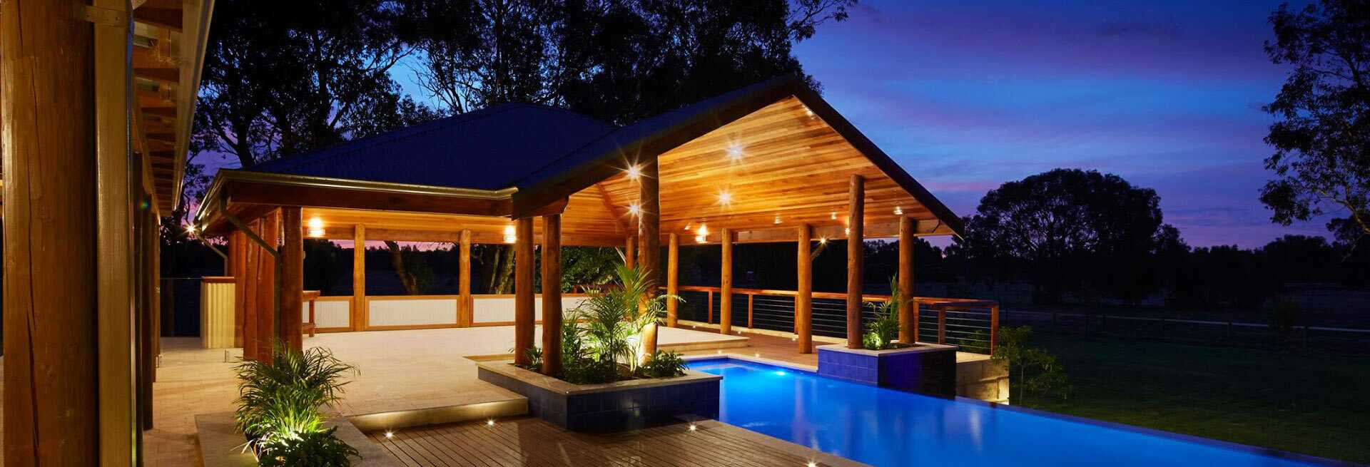 The water 39 s edge pool design and landscaping for Pool hut designs